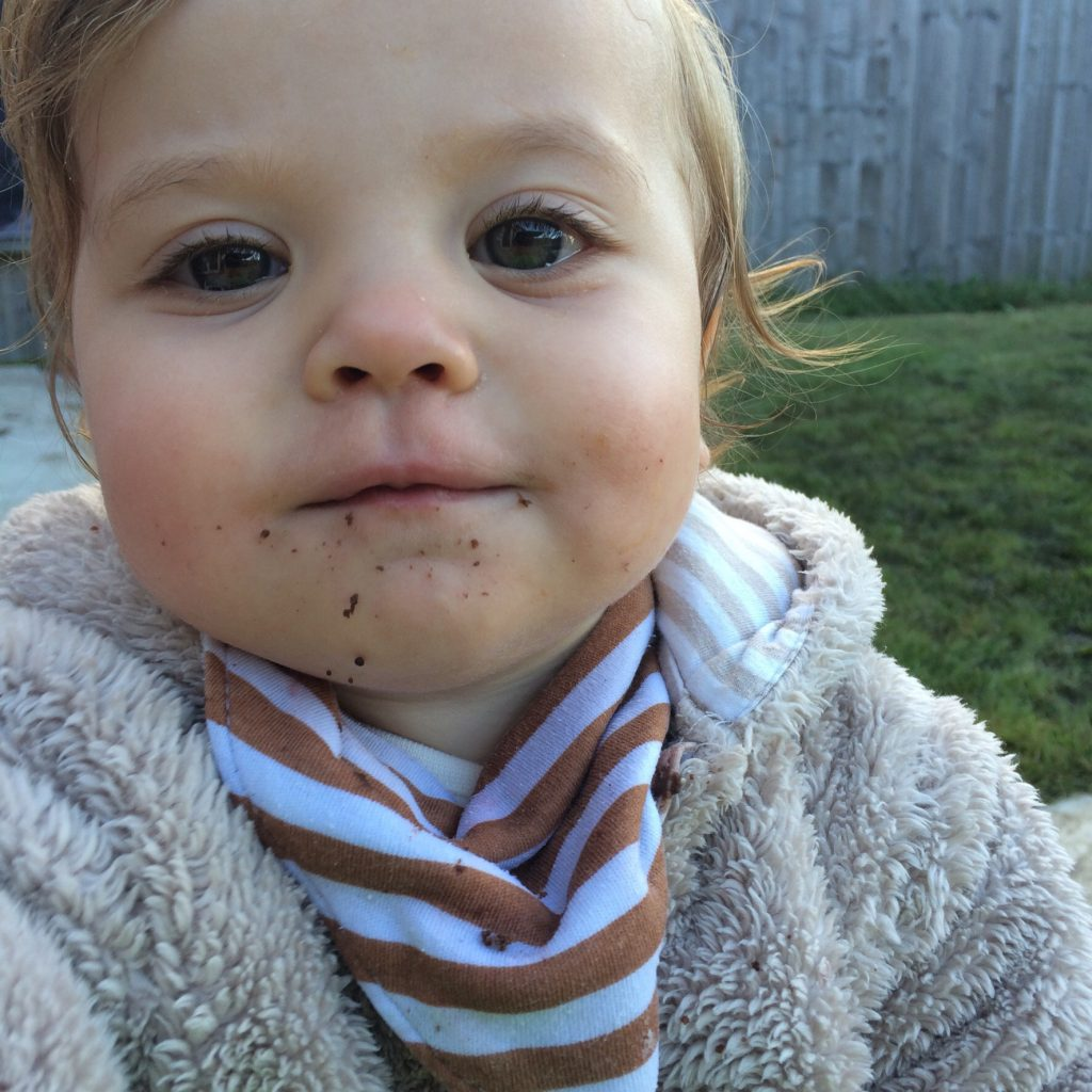 My daughter with cake crumbs on her face