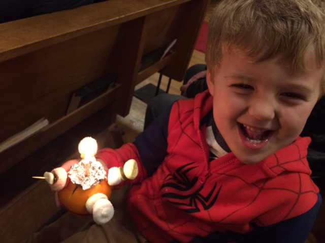 Harry holding a Christingle